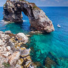 Europe - Spain - Balearic Islands archipelago - Majorca - Mallorca - Rock Arch Es Pontas at Cala Santanyi - Impressive huge offshore natural stone arch in turquoise waters of Mediterranean Sea