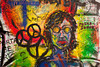 Prague, Czech Republic - October 7, 2010:  A portrait of John Lennon with peace symbols is a small detail in the graffiti on the Lennon Wall in the Little Town of Prague near the Charles Bridge.This landmark wall is open to public graffiti in remembrance of John Lennon.