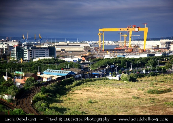 Europe - UK - Northern Ireland - Belfast - Béal Feirste - Capital of NI along river Lagan - Abhainn an Lagáin - Central Cityscape along newly developed waterfront captured from above - Samson & Goliath - Twin shipbuilding gantry cranes situated at Queen's Island