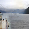 Cruise ship sails along the Breaksea Sound in Fiordland National Park, New Zealand.