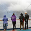 Cruise passengers enjoying scenic view along the Breaksea Sound in Fiordland National Park, New Zealand.