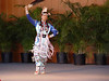 <b>Kehewin Native Performance - Jingle Dress Dance</b> celebrated the healing power and dignity of the Ojibwa woman. This dance has its origins in northern Minnesota and was introduced to the Pan-Indian community by the Ojibwe people. As the story goes, a medicine man's granddaughter was very ill. He had a dream in which a spirit wearing the jingle dress came to him and told him to make one of these dresses and put it on his daughter to cure her. When he awoke, he and his wife proceeded to assemble the dress as described by the spirit of his dream. When finished, they and others brought his granddaughter to the dance ha ll and she put on the dress. During the first circle around the room, she needed to be carried. During the second circle around the room, she could barely walk and needed the assistance of several women. The third circle around the room she found she coul d walk without assistance and during the fourth circle around the room, she danced.