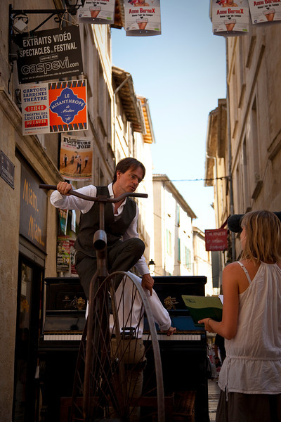 I don't really know what's going on in this picture, but then, it was Festival time in Avignon, and I saw some fairly strange things as I wandered the streets. This guy appears to be hauling a piano (complete with piano player) using a 19th-century bicycle, which is definitely the most efficient manner of hauling a piano.