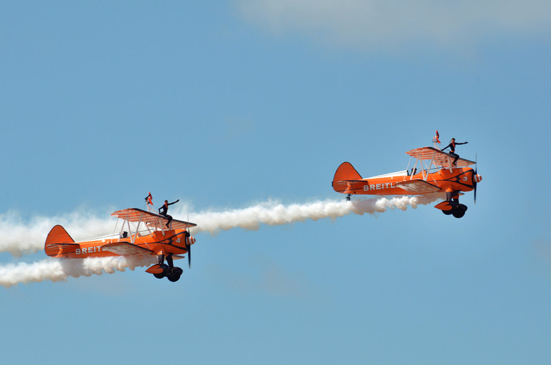 SOUTHPORT, ENGLAND - JULY 23: Two Orange Breitling Bi-planes perform aerobatics and mid air stunts on July 23, 2011 in Southport, England.