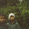 My brother an I at age 7 in Rwanda, investigating the murder of Diane Fossey the main character in Gorillas in the Mist. That is a mountain gorilla behind us on this cold wet day.  A young gorilla eventually ate the green poncho off my brother because he thought it was a huge piece of edible vegitation.