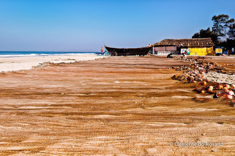 Fishing nets stretched out on Vraca Beach in Goa, India