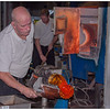 Removing nearly molten glass from the furnace