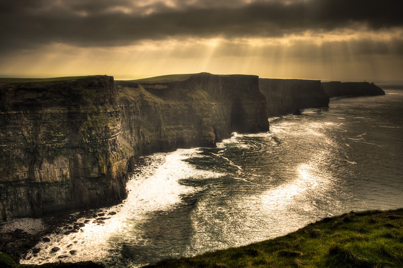Sun breaks out over the Cliffs of Moher on the west coast of Ireland
