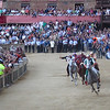 Lap 2 of the Palio.  The horse on the outside is freelancing with no rider