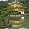 Golden Pavilion - History<br /> In the 1220's it was the comfortable villa of Kintsune Saionji. Yoshimitsu, the 3rd Shogun of Ashikaga, abdicated the throne in 1394. After three years, he began to build Kitayamaden and he made a special effort to make it a breath-taking site. He indulged in his peaceful life in this serene setting. After Yoshimitsu's death, Kitayamaden was made into a Zen temple in accordance with his will. All the buildings of those days came to ruin except Kinkaku. The garden, however, remains as it was in former days and can be enjoyed as it was hundreds of years ago. Kinkaku-ji Temple was inscribed as World Cultural Heritage in 1994.
