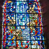 "One of two stained glass windows in the Church of St. Mère Église depicting the airborne operations of D-Day. The window was designed by a local artist named Paul Renaud, who was 14 years old at the time of the landing.<br /> <br /> The window depicts the Virgin Mary with Child above a burning St. Mère Église with paratroops descending on either side. The inscription at the bottom reads, ""This stained glass was completed with the participation of Paul Renaud and Sainte Mere, for the memory of those who, with their courage and sacrifice, liberated Sainte Mere Eglise and France""."
