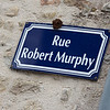 It is generally agreed that Robert Murphy was the first American soldier to touch French soil on D-Day. At about a quarter past midnight on June 6, 1944, Murphy, a member of the 505th Parachute Infantry Regiment of the 82nd Airborne Division, touched down near St. Mère Église. His was the only regiment to land intact on D-Day and exactly where it was supposed to, on a high grassy meadow, a mile due west of the town.<br /> <br /> Murphy was a member of a pathfinder regiment, charged with marking drop zones. He was awarded the Bronze Star and the French Legion of Merit for his efforts on D-Day.<br /> <br /> Murphy retired from the Army as a colonel and went on to become assistant state attorney general in Massachusetts. He devoted a significant portion of his life to assuring that the events of D-Day would not be forgotten. From the 1960s until the year of his death, he visited Ste. Mere Eglise every June 6 and often parachuted into the town with other veterans. Murphy died in October 2008 at the age of 83.