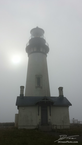 "The Yaquina Head Lighthouse immersed in fog. The lighthouse stands 93 feet tall, putting it's light 162 feet above the waters of the Pacific. It was built in 1873 and originally used a 1st-order Fresnel Lens with a 4-wick lard oil lamp. The lamp was replaced by electricity in 1933, and completely automated in 1966. The house is still lit every night to guide ships into Newport.<br /> <br /> Information courtesy of Bella Terra's ""Northwest Lighthouses - Illustrated map and guide"""