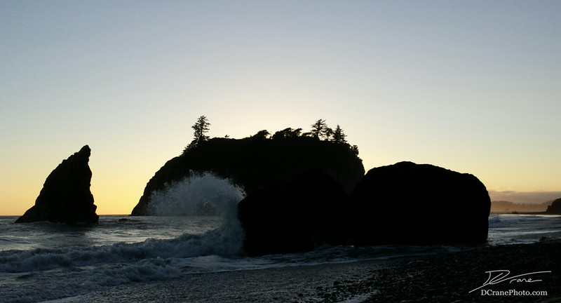 Waves from the incoming tide crash into the rocky shores of Ruby Beach in Olympic National Park.