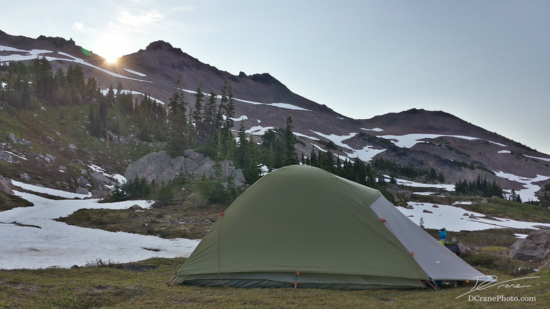 Our third night in the Goat Rocks Wilderness was spent just off the PCT near the base of Old Snowy and Ives Peak. Having woken at 5 am to capture the sunrise only to find ice on the tent and frozen rivers all around us, we were ecstatic to finally see the sun appear over the ridge.