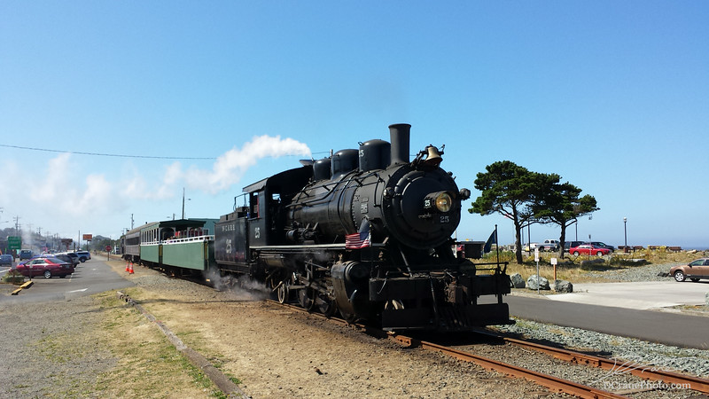 Oregon Coast Scenic Railroad's steam engine #25 gets ready to head back to the station in Garibaldi, Oregon from its current location in Rockaway Beach. The scenic train ride brings riders along the beautiful Oregon Coast and stops in Rockaway where they can get out and explore the town, beaches, and shops before heading back to Garibaldi.