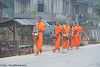 """Lao Monks In the Morning Mist On Their Daily Alms Walk - """"Tak Bart"""", Ban Khone, Luang Nam Tha Province, Lao People's Democratic Republic"""