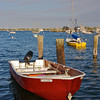 A red motorboat docked in Nantucket's waters