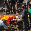 Preparing a body for cremation at Pashupatinath Temple on the banks of the Bagmati river, Kathmandu.  Funerals are open air, but a men-only affair.