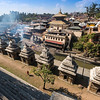 Smoke from cremations on the ghats of Pashupatinath Temple on the banks of the Bagmati river, Kathmandu.