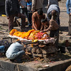 Preparing a body for cremation at Pashupatinath Temple on the banks of the Bagmati river, Kathmandu.