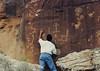 Zuni Rock Art, Zuni Petroglyphs and Zuni Pictographs<br /> <br /> These pictographs are on a sandstone overhang near an ancient site known as Village of the Great Kivas on the Zuni Pueblo. <br /> <br /> The Kachina religion (katsina or katchina) is central to the Zuni, Hopi, Zuni, and Acoma people. <br /> <br /> Kachinas are spirits, in some cases those of ancestors, who carry prayers from the people to the gods. They appear in ceremonials, usually dances, at critical times of the year. Individual kachinas are associated with particular clans within the Pueblo. Members of those clans wear masks that represent the kachinas, and in wearing the mask the spirit of the kachina takes over the person. <br /> <br /> Kachinas can represent animals, ogres, imaginary spiritual characters, and even members of other ethnic groups. The rock art shown in the following images is from Zuni Pueblo.