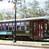 Historic St Charles Avenue Streetcar whizzing by in Uptown New Orleans