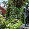 Statue of Edvard Grieg and the cottage where he composed on the grounds of his home.