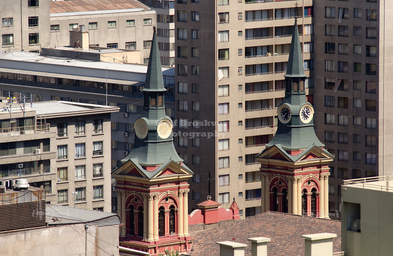 The steeples of La Merced Basilica sticking out of the concrete jungle of downtown Santiago de Chile.