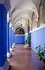 Arcade with blue and white columns in the Orange Tree Cloister of the Santa Catalina Monastery in Arequipa, Peru