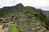 The quarry area with the caretaker's hut and the peak of the Machu Picchu mountain at the ancient Inca site of Machu Picchu, Peru