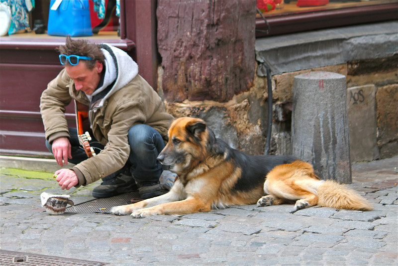 Photofreak. Street performer and his dog. Rouen, Normandy. France.