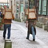 Photofreak. Two men with chairs on their heads. Rouen, Normandy. France.