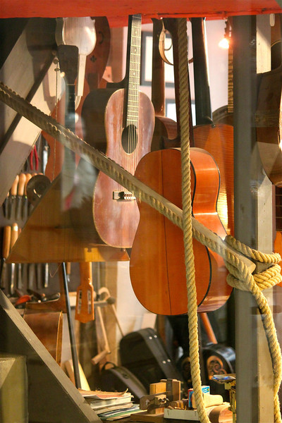 Photofreak. Handmade guitars hang in a shop in Rouen. Rouen, Normandy. France.