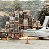 Media Burn by Ant Farm  The Phantom Dream Car crashes through a wall  of burning television sets before a cheering crowd  at the Cow Palace in San Francisco, July 4, 1975