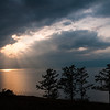 A near glimpse of the sun over Lake Baikal. Olkhon Island, Siberia - Russia