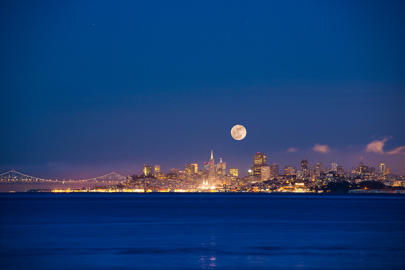 "Full Moon rises over San Francisco as evening settles over the City as seen from Sausalito. The format of this image has a traditional cropping to yield a 20"" x 30"" print on paper or on metal or a print of similar size ratio."