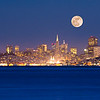 "Full Moon rises over the San Francisco skyline as evening settles over the City as seen from Sausalito.The format of this image has been cropped to yield a panoramic 12"" x 36"" print on paper or on metal."