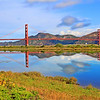 """The towers of the Golden Gate Bridge are reflected in the still waters of Crissy Field Marsh as an oil tanker heads out to sea. This is a full-framed image in the traditional digital ratio of 2:3, so it will enlarge without cropping to 20"""" x 30"""" or larger."""