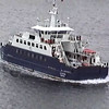Ferry boat cruising along at the Port of Lerwick in the Shetland Islands of Scotland, United Kingdom.