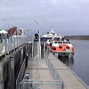 Cruise ship passengers boarding a tender boat at the Port of Lerwick in the Shetland Islands of Scotland, United Kingdom.