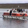 Tender boat transfers passengers back to the cruise ship at the Port of Lerwick in the Shetland Islands of Scotland, United Kingdom.