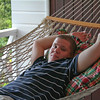 Don making himself comfortable on the porch hammock
