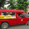 Songthow-these red trucks will take you anywhere inside the city of  Chang Mai for $1.  Flag them down tell them where you want to go and hop in the back.