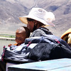 Tibetan mother with small boy on ferry.