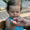 Sadie playing with Shrimp. (that kid will eat anything!)