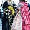 Two generations in beautiful costumes on Venetian carnival 2014, Venice, Italy