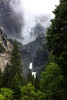 Yosemite Falls tumbling out of the clouds above