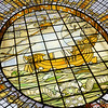 "The Glass Dome in Neiman Marcus was built in 1909.  The ship was the official seal of the City of Paris Department Store.   The Latin inscription translates: ""It Floats, but does not sink.""<br /> <br /> In 1981 the 2,600 pieces of the City of Paris stained glass dome were sent to Massachusetts for restoration.  In 1982 it was reinstalled by Neiman Marcus as the focal point of its Rotunda Restaurant."
