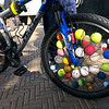 A biker walked by with these balls in his wheels. Why? Why not?